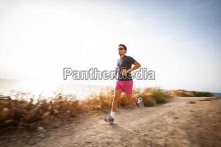 caucasian young man running on a