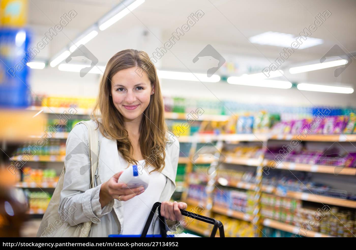 beautiful, young, woman, shopping, in, a - 27134952