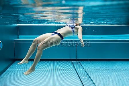 below water photo of woman swimming