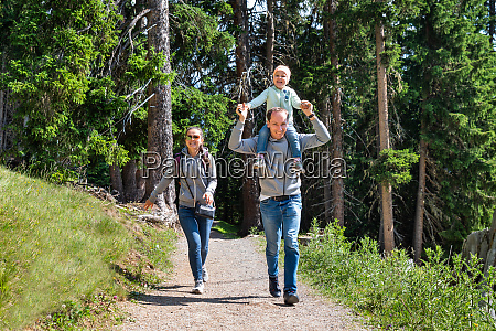 family walking hiking trail
