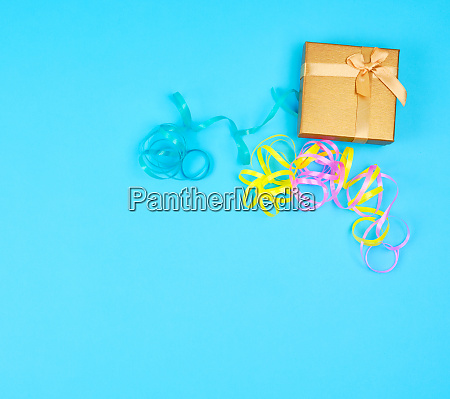 closed golden gift box with a