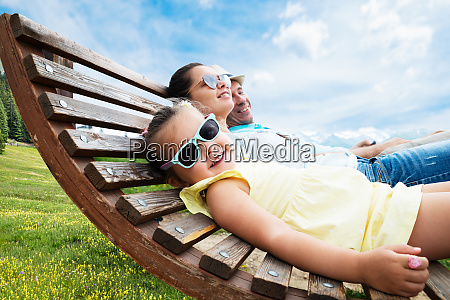 family with little relaxing in sun