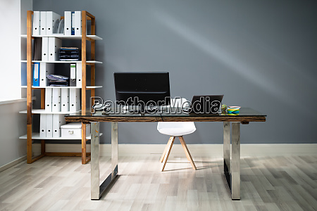 computer on desk in modern office