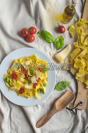 tagliatelle in italian colors roasted tomatoes