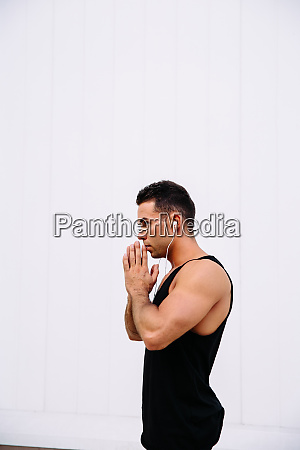 side view of meditating man against