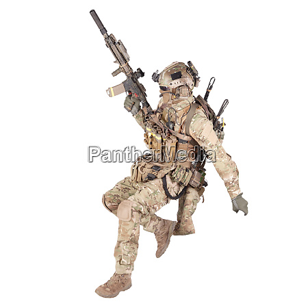 soldier running with rifle isolated studio