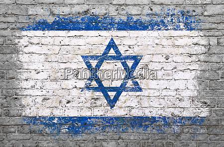 flag of israel painted on brick