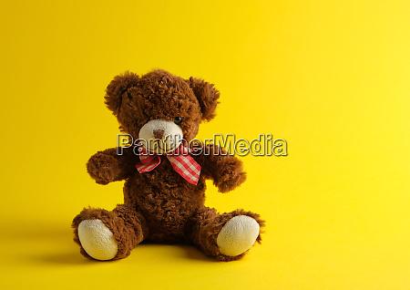 brown teddy bear sitting on a