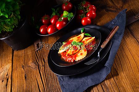 ravioli alla genovese with basil tomato