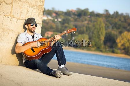 hipster playing guitar