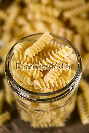 raw rotini or fusilli pasta
