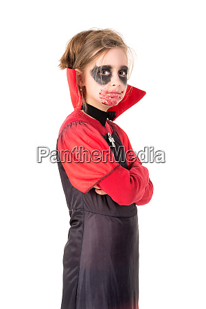 kid in halloween costume