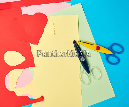 pair of plastic scissors and colored