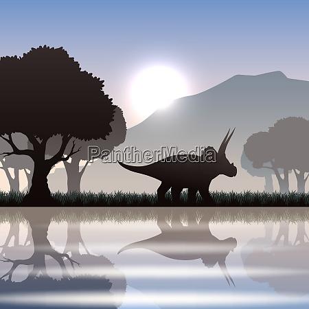 triceratops dinosaur silhouette in scenic landscape