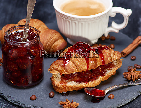 croissant with strawberry jam and white