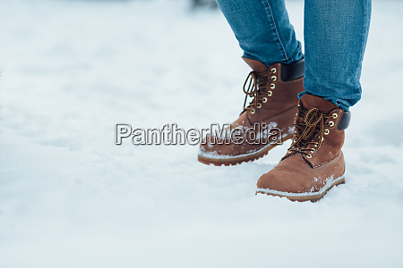 mens winter boots on snow brown