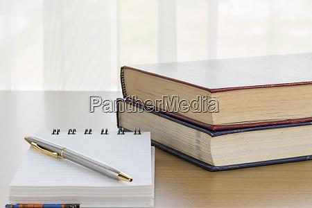 pen put on notepad open blank