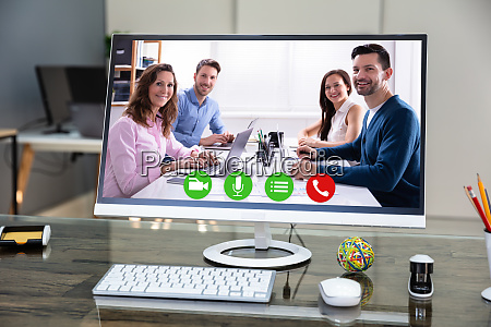 computer desktop with videoconferencing application on
