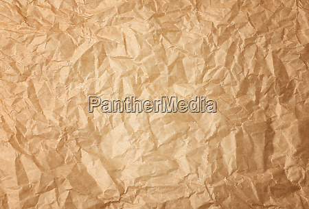 crumpled brown baking parchment paper full