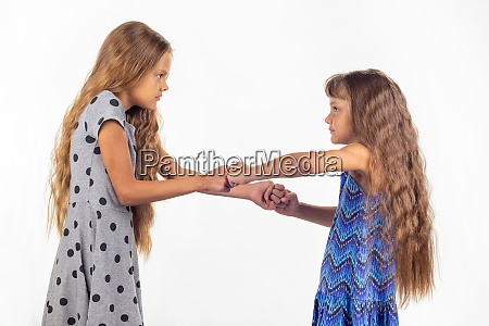 two girls fight grabbing each others