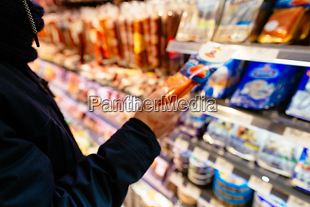 shopping in supermarket man check the
