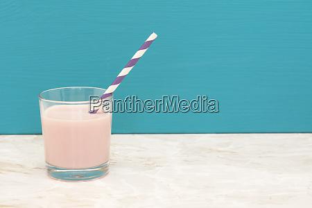 delicious strawberry milkshake with a straw