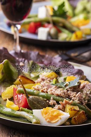 closeup of salade nicoise on dark