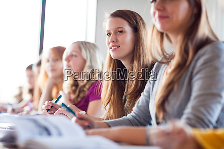 students in classroom young pretty