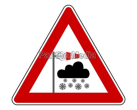 verkehrsschild schneesturm auf weiss