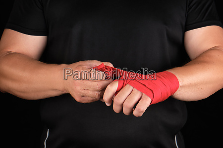 athlete stand in black clothes and