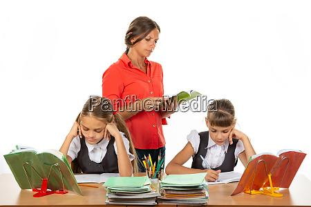 schoolchildren at the desk do the