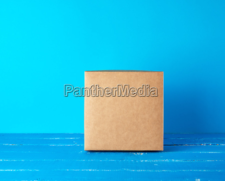 closed square brown gift box on
