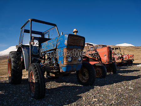 several vintage tractors of different brands