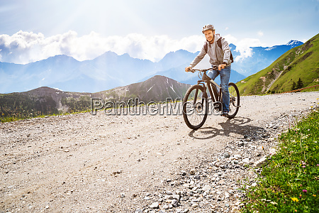 man riding electric mountain bike