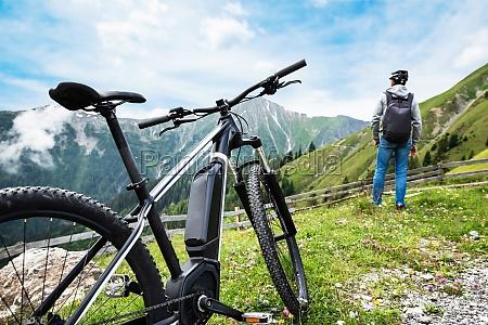 man enjoying view after finishing uphill