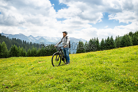 main on mountain with his bike
