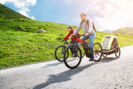 family with child in trailer riding