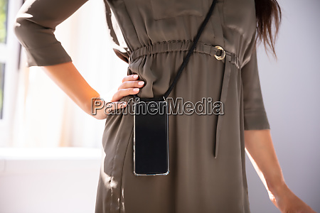 woman carrying mobile phone