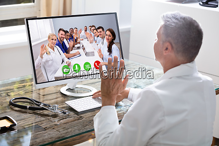 doctor having video conference on laptop