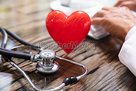 heart in front of doctor working