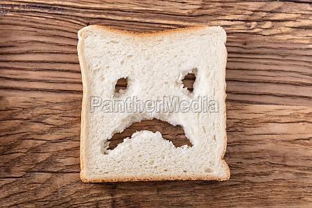 sad face on slice of bread