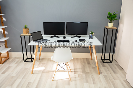 computer on desk in modern office