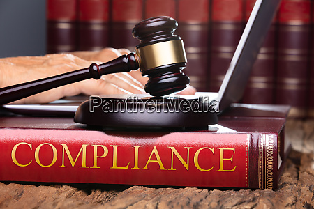 judge gavel and soundboard on compliance