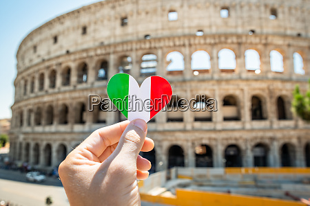 person holding heart shaped italian flag