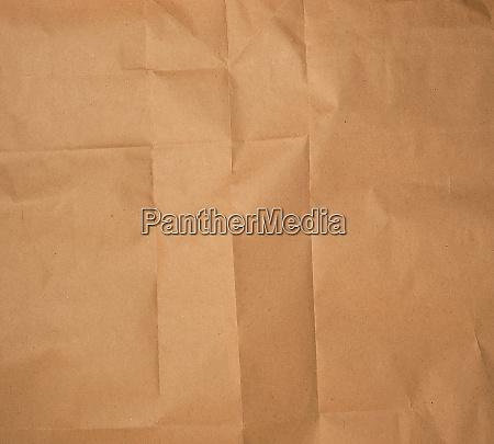 crumpled brown sheet of paper full