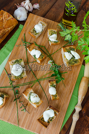 toast with mozzarella olive oil herbs