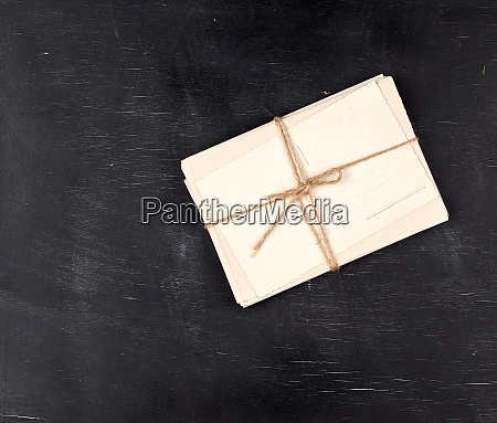 white paper cards tied with a