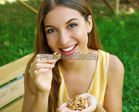 beautiful young woman smiling and eating