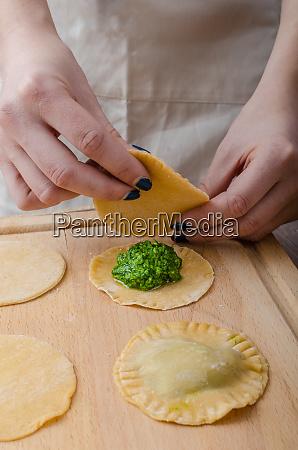 chef prepares ravioli