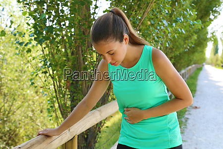 woman has side cramp young woman